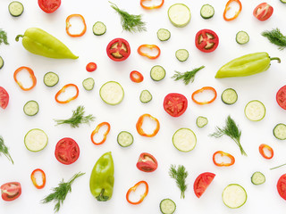 Fototapete - Vegetables on a white background. Pattern of vegetables. Food background. Collage of food. Top view. Composition of  peppers, cucumbers, tomatoes, dill.