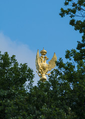 Three-headed golden eagle on the roof of the State Hermitage Museum, St. Petersburg, Russia