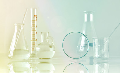 Group of scientific laboratory glassware with clear liquid solution, Research and development concept.