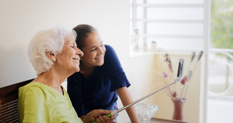 Generations Gap Happy Old Woman And Granddaughter Taking Selfie
