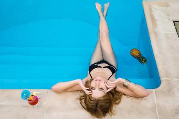 woman in the hotel near swimming pool