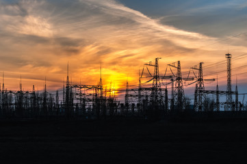Sunset against the background of the power distribution station