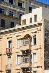 Traditional buildings with balconies in the city centre, Valletta, Malta.