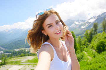 Beautiful girl taking a selfie. Rosa Khutor