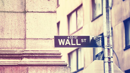 Wall Street sign, shallow depth of field, color toning applied, New York City, USA.