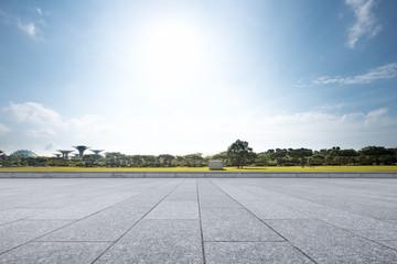 empty floor near park in blue sky