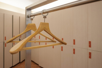 Empty wooden hanger in cloakroom.