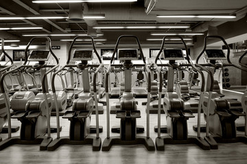 Row of Elliptical in gym. Black and white style.