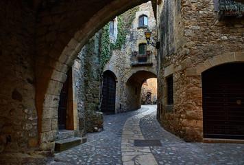Doorgang of Carrer Major street in the medieval historic downtown of Pals. Bajo Ampurdan, Girona, Catalonia, Spain. Wall mural