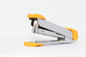 Yellow stapler on a white background