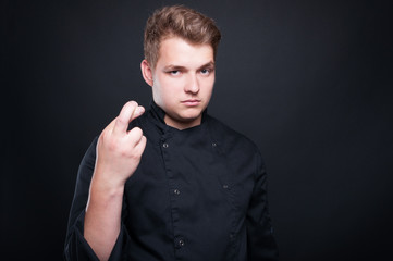 Male cook or chef wishing bad luck