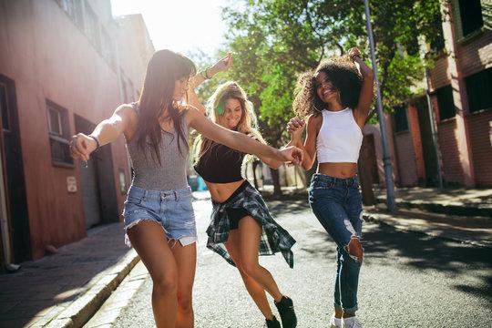 Friends having fun on city street