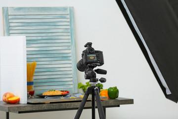Professional camera on tripod while shooting food