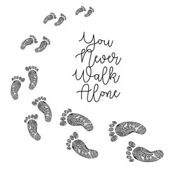 """""""You never walk alone """" handwritten with footprints in decorative style."""