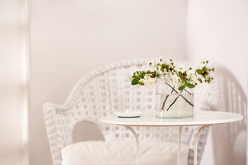 Vase with beautiful flowers on table at home