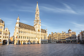 Morning view on the city hall at the Grand place central square in the old town of Brussels during the sunny weather in Belgium