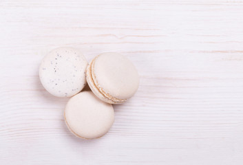 Fotobehang Fresh, cream-colored macaroons on a white background