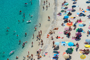 Overhead view of people at the beach, holiday concept