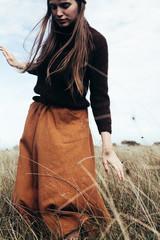 Beautiful woman alone in field