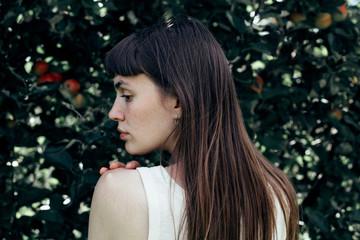 Beautiful woman in apple orchard