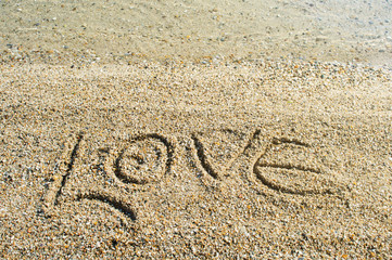 Word Love written on the beach
