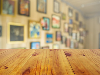 Wooden board empty table in front of blurred background. Perspective brown wood over blur in coffee shop or cafe- can be used for display or montage your products.Mock up your products.Vintage filter.