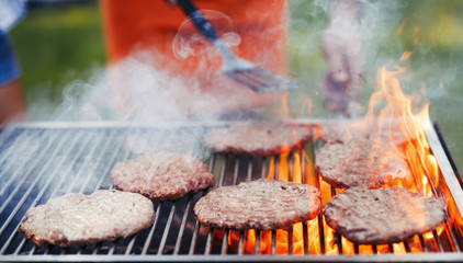 Picture of delicious burgers grilled on barbecue