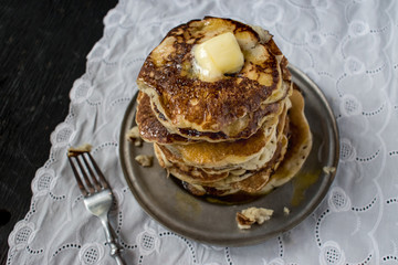 top view of homemade pancakes with butter and syrup