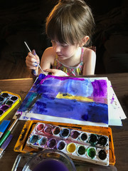 young girl painting watercolors