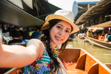 women taking selfie on floating market holiday