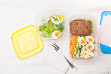Cut vegetables, sandwich in an open food container