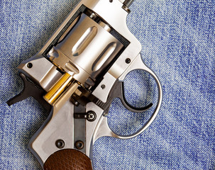 Nagan revolver with cartridge