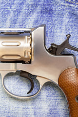 Nagan revolver on blue jeans background