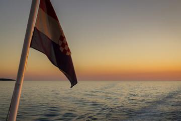 Croatian flag at sunset