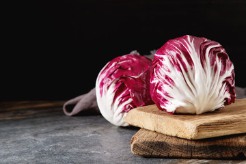 Radicchio on a dark background. Food for a vegan and a vegetarian. Diet, food concept.