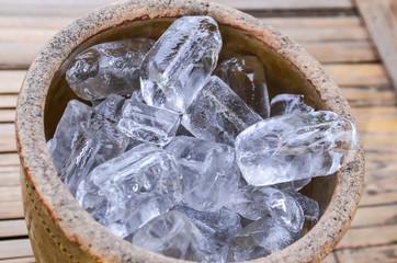 Ice cubes in a wooden bucket