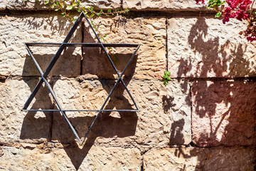 Star of David on the stone wall background