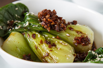 Cooked bok choy or chinese cabbage with sesame and soy sauce. Simple background. Healthy food. Lifestyle.