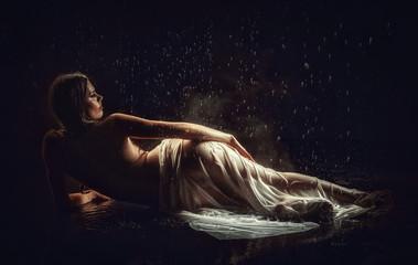 beautiful woman in aqua in the rain