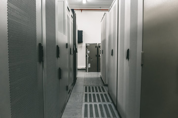 Switchgear room with raws of cabinets with network or cellular hardware