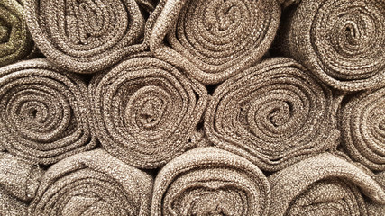 group of brown fabric roll selection / stock of brown fabric for fashion design business, raw material in garment manufacturing