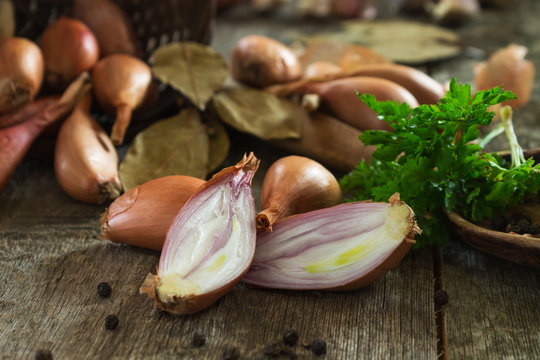 whole and cut schnillon onion in a blurred background