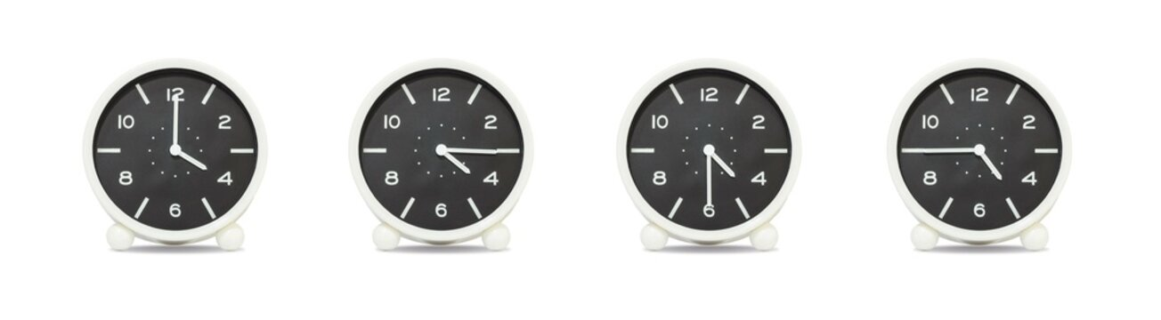 Closeup group of black and white clock for decorate show the time in 4 , 4:15 , 4:30 , 4:45 p.m. isolated on white background , beautiful 4 clock picture in different time
