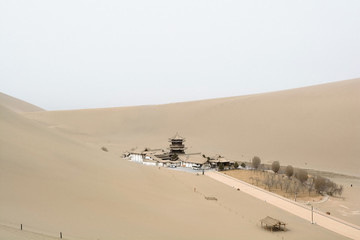 Beautiful view of Crescent moon Lake in Mingsha Mountain the desert in Dunhuang, China