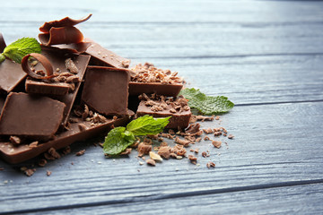 Dark chocolate pieces on wooden table