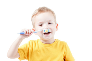 Pretty kid with mustache child toothbrush isolated on white background