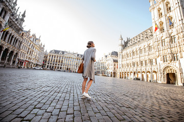 Young female tourist walking on the main square with city hall in the old town of Brussels in Belgium