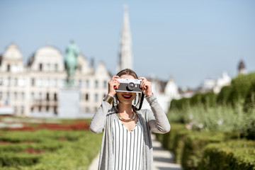 Young female traveler standing with photocamera on the famous Arts mountain with great view on the old city in Brussels