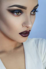 Close up of charming young lady with healthy skin and beautiful professional make up