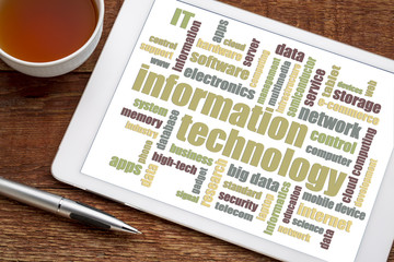 Wall Mural - information technology word cloud on tablet
